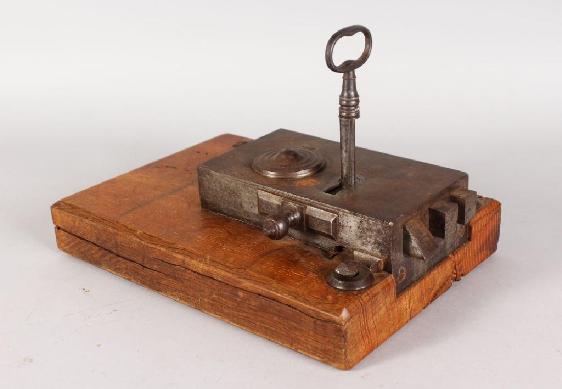 AN 18TH CENTURY FRENCH DOUBLE ACTION LOCK AND KEY with