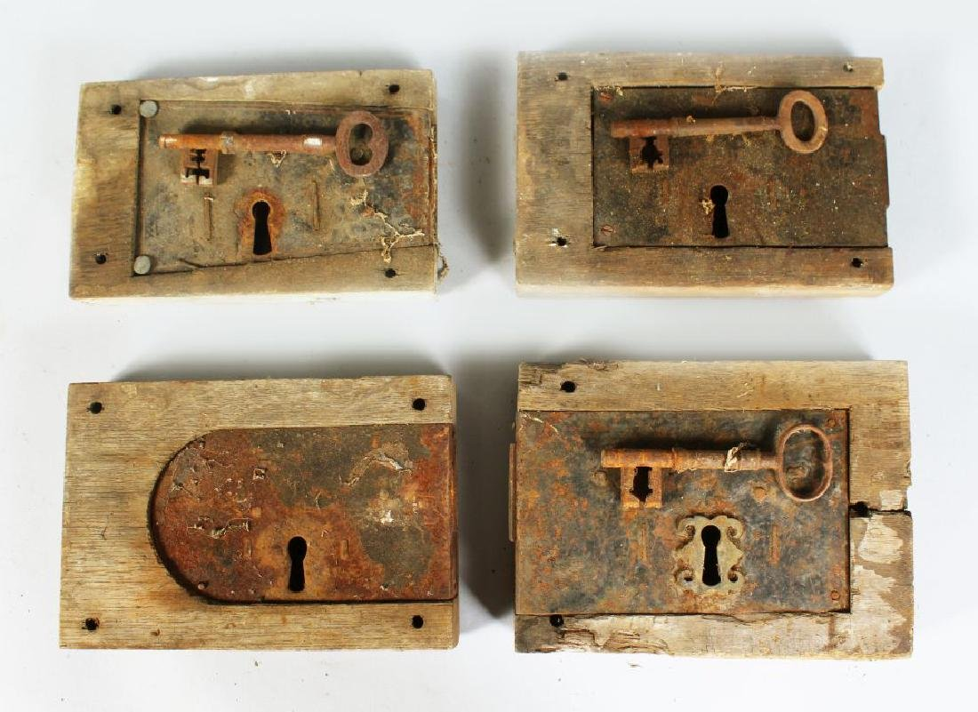 FOUR 19TH CENTURY MORTICE LOCKS, three with keys, all
