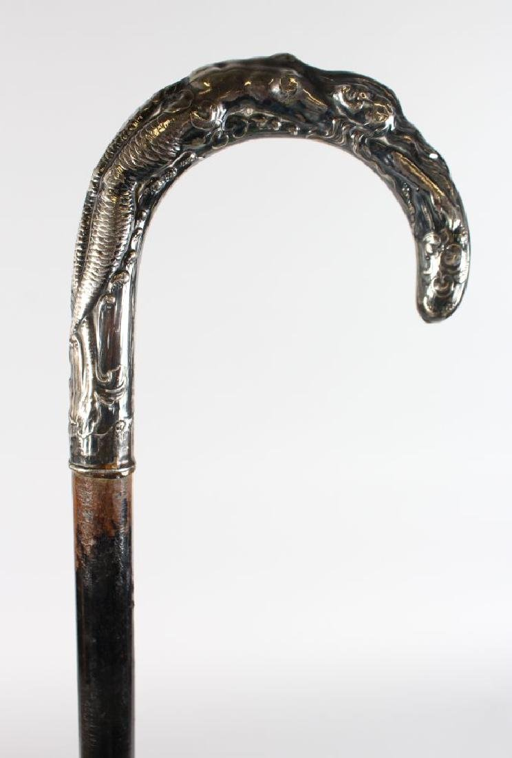 A WALKING STICK WITH CHINESE SILVER HANDLE.