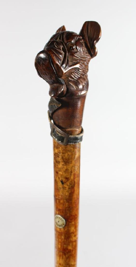 """A WALKING STICK with carved wooden """"DOG"""" handle by"""