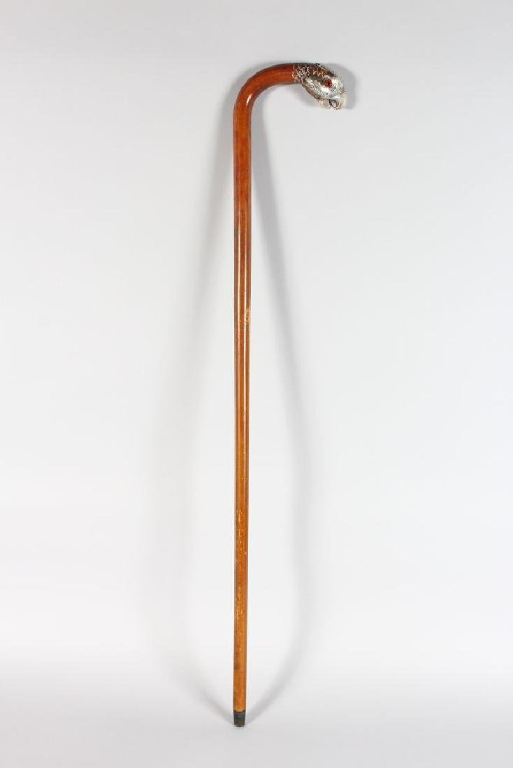 A WALKING STICK WITH SILVER BIRDS HEAD HANDLE. - 2