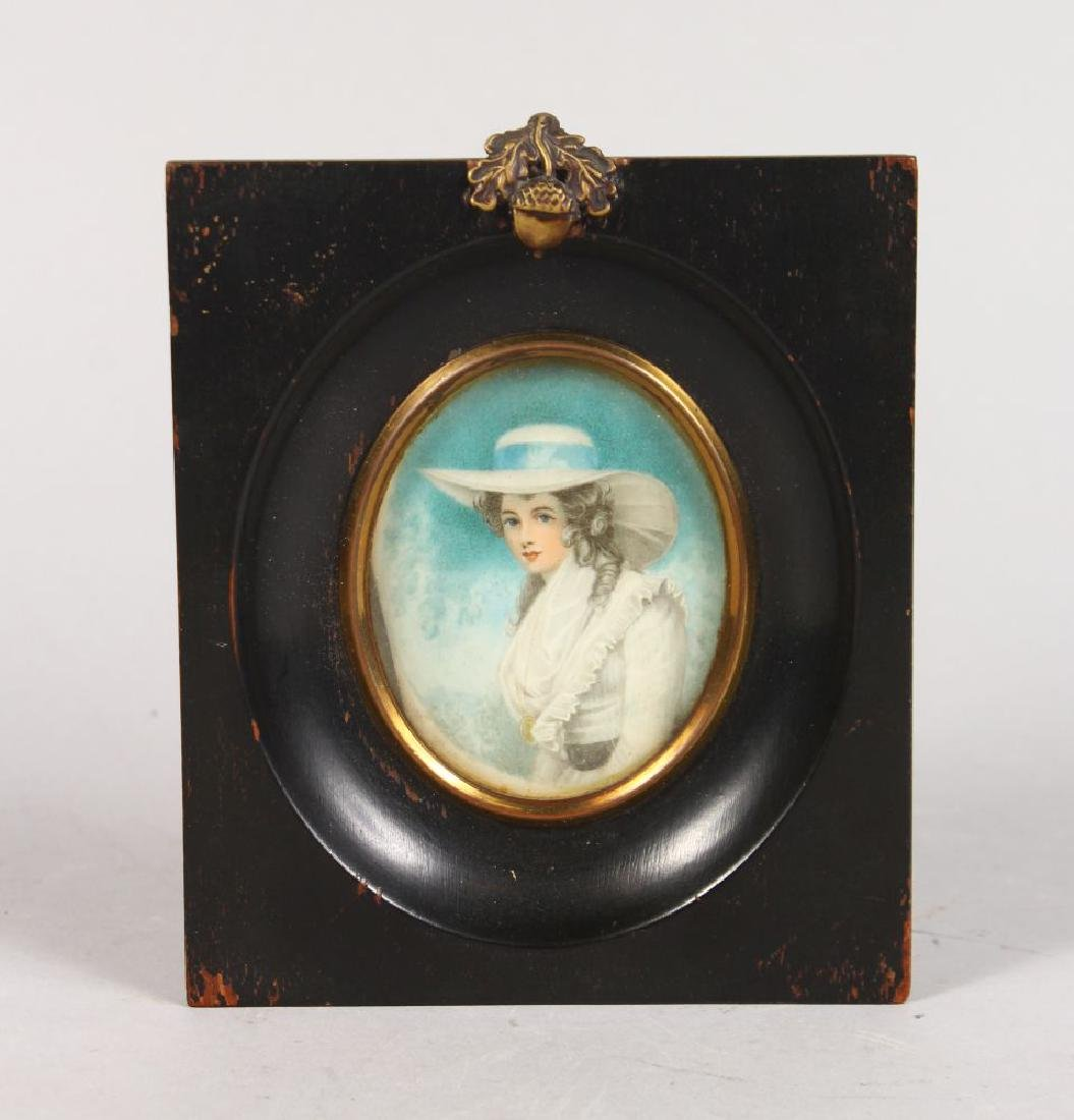 A FRAMED OVAL PORTRAIT OF A YOUNG LADY.  3ins x