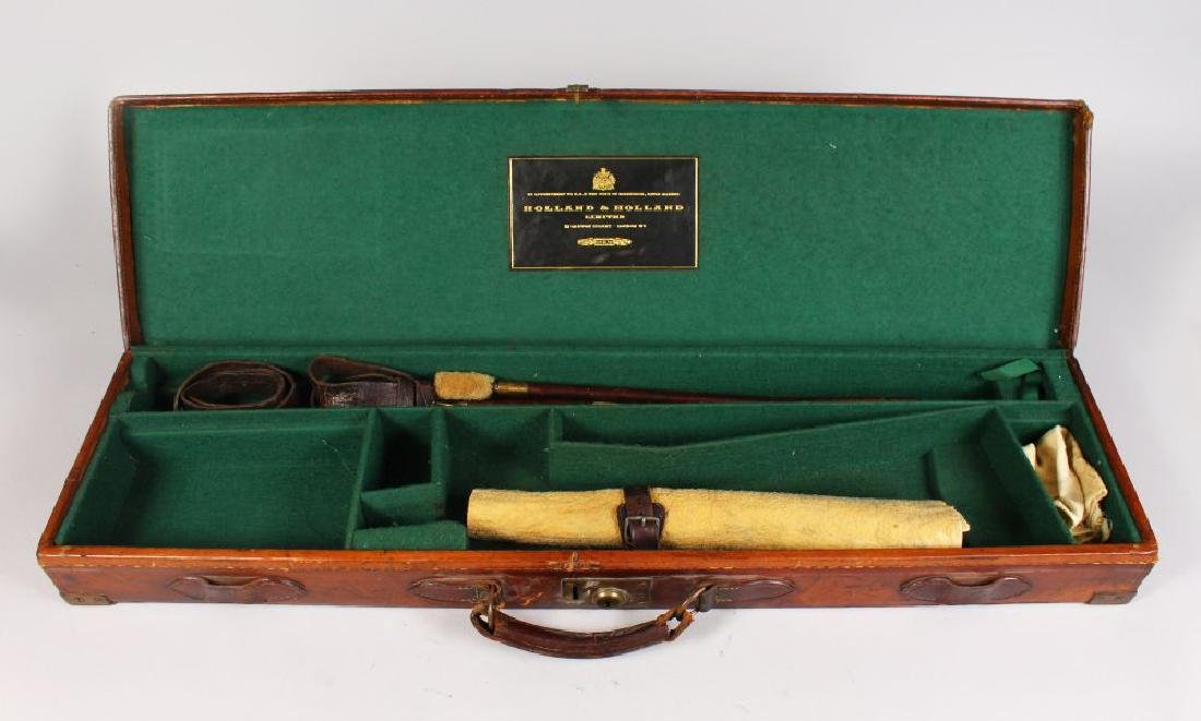 A HOLLAND & HOLLAND LEATHER GUN CASE, label inside lid.