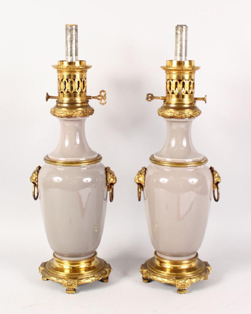 A GOOD PAIR OF LOUIS XVI DESIGN GREEN PORCELAIN AND