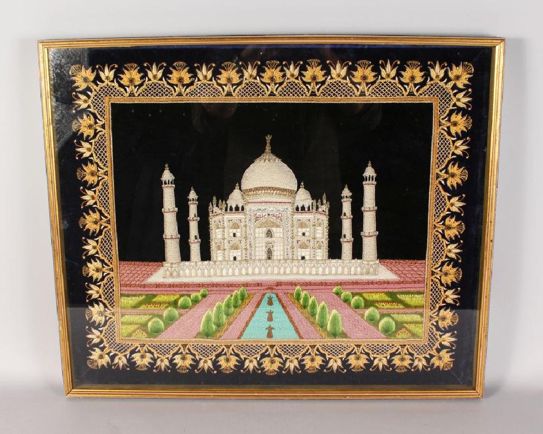 A FRAMED SILKWORK PICTURE OF THE TAJ MAHAL.  21ins x