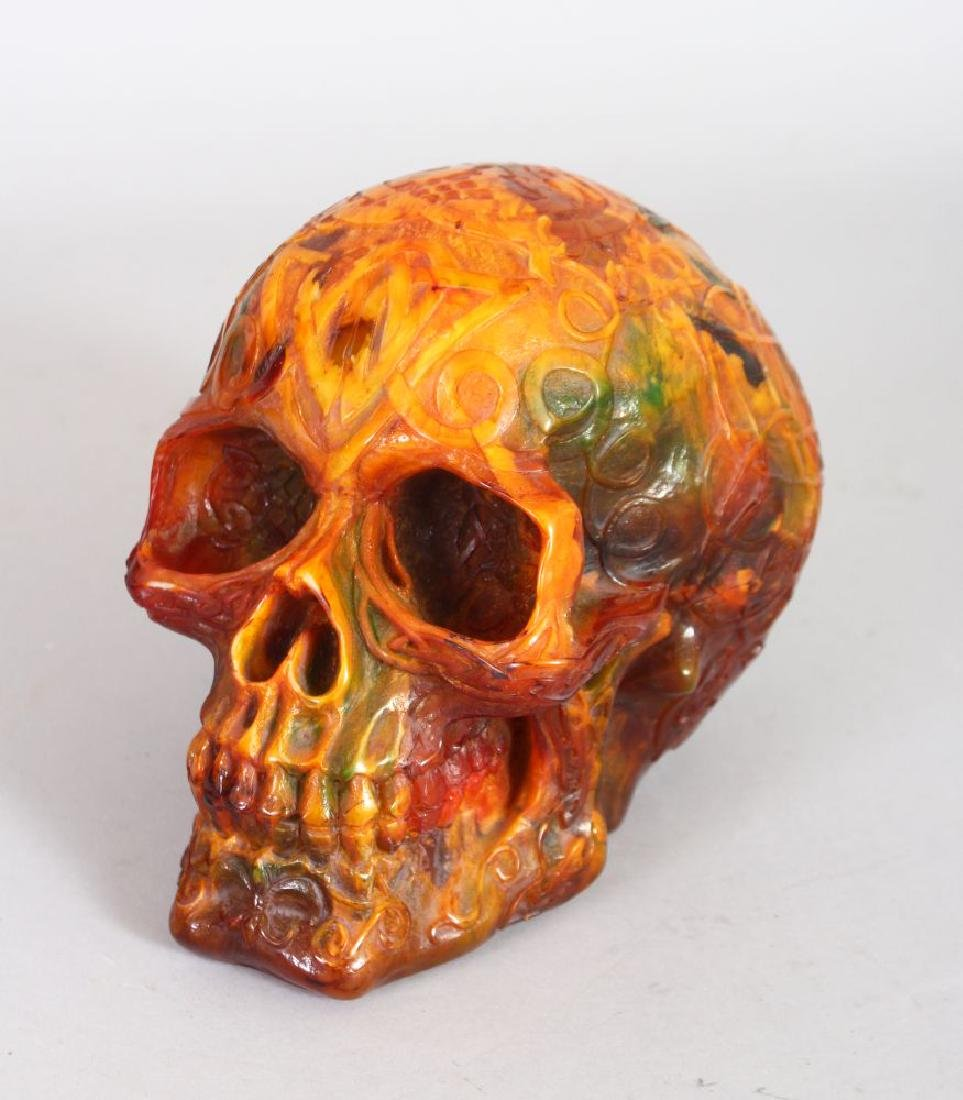 AN UNUSUAL AMBER STYLE MODEL OF A HUMAN SKULL.  5ins