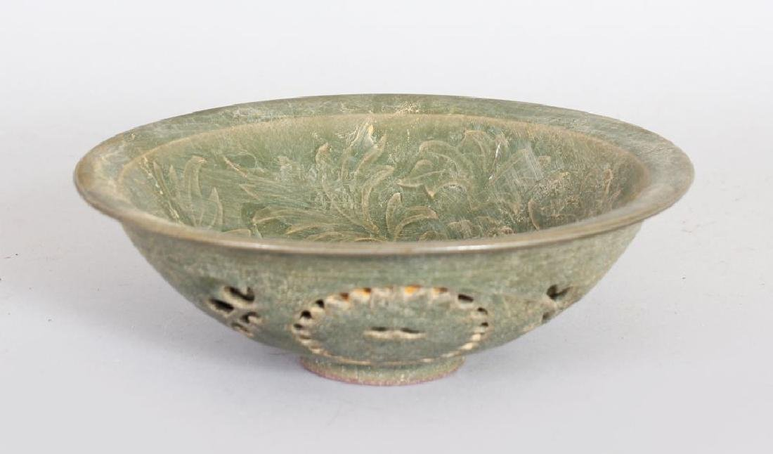 A CHINESE GREEN CELADON POTTERY BOWL, with pierced