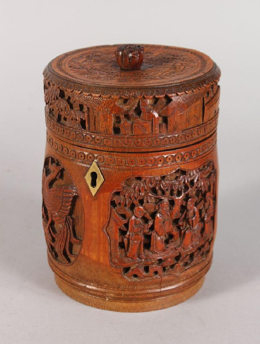A CHINESE CARVED CIRCULAR BAMBOO BOX AND COVER, carved