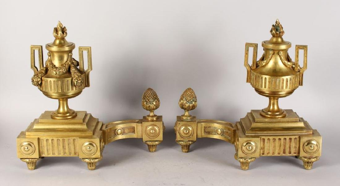 A GOOD PAIR OF LOUIS XVI DESIGN GILT BRONZE CHENETS