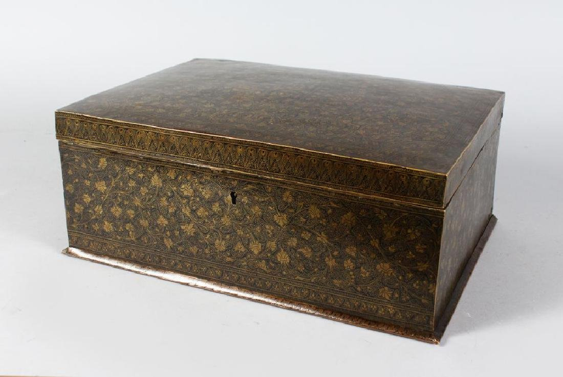 AN ISLAMIC BRASS INLAID BOX AND COVER with hinged lid.