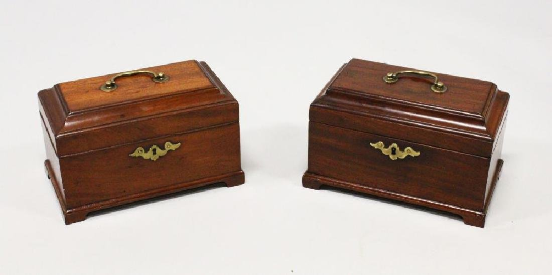 A NEAR PAIR OF GEORGE III MAHOGANY TEA CADDIES, with
