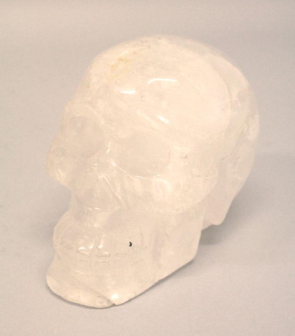 A CARVED ROCK CRYSTAL HUMAN SKULL.  5ins high.