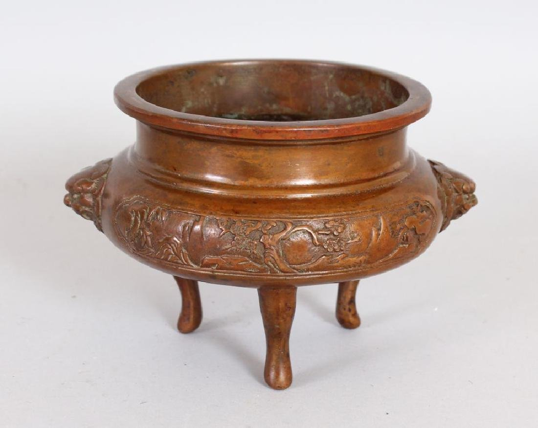 A CHINESE BRONZE CENSER, with lion mask handles, on