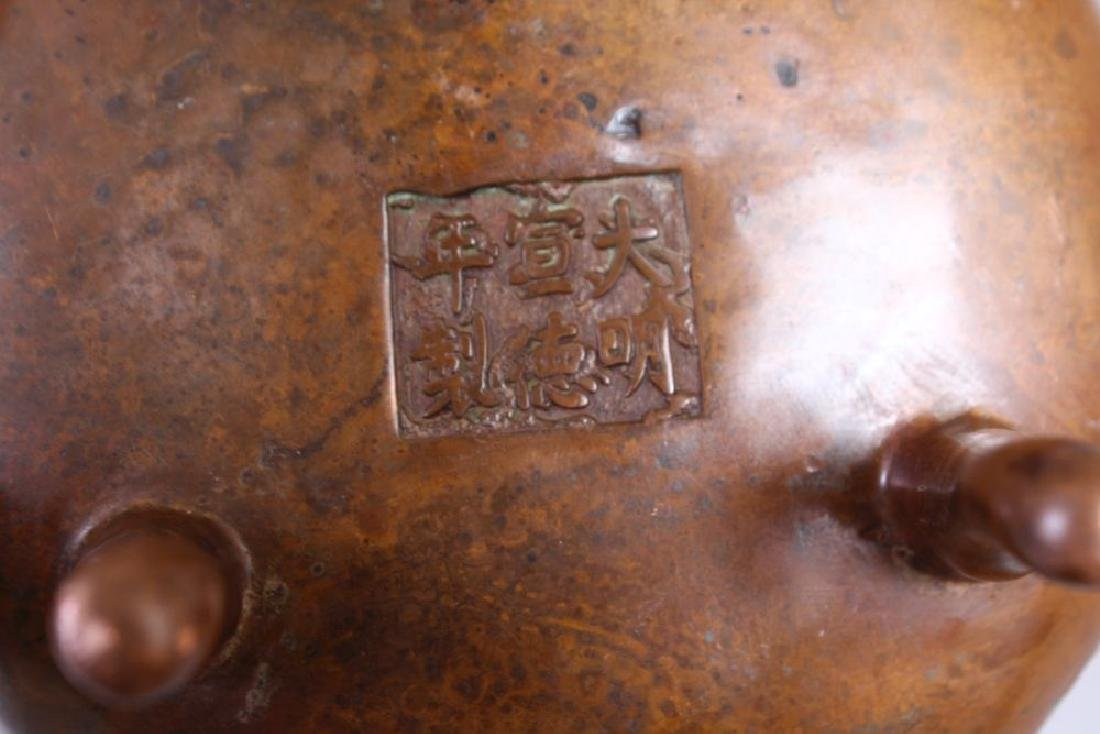 A CHINESE BRONZE CENSER, with lion mask handles, on - 2
