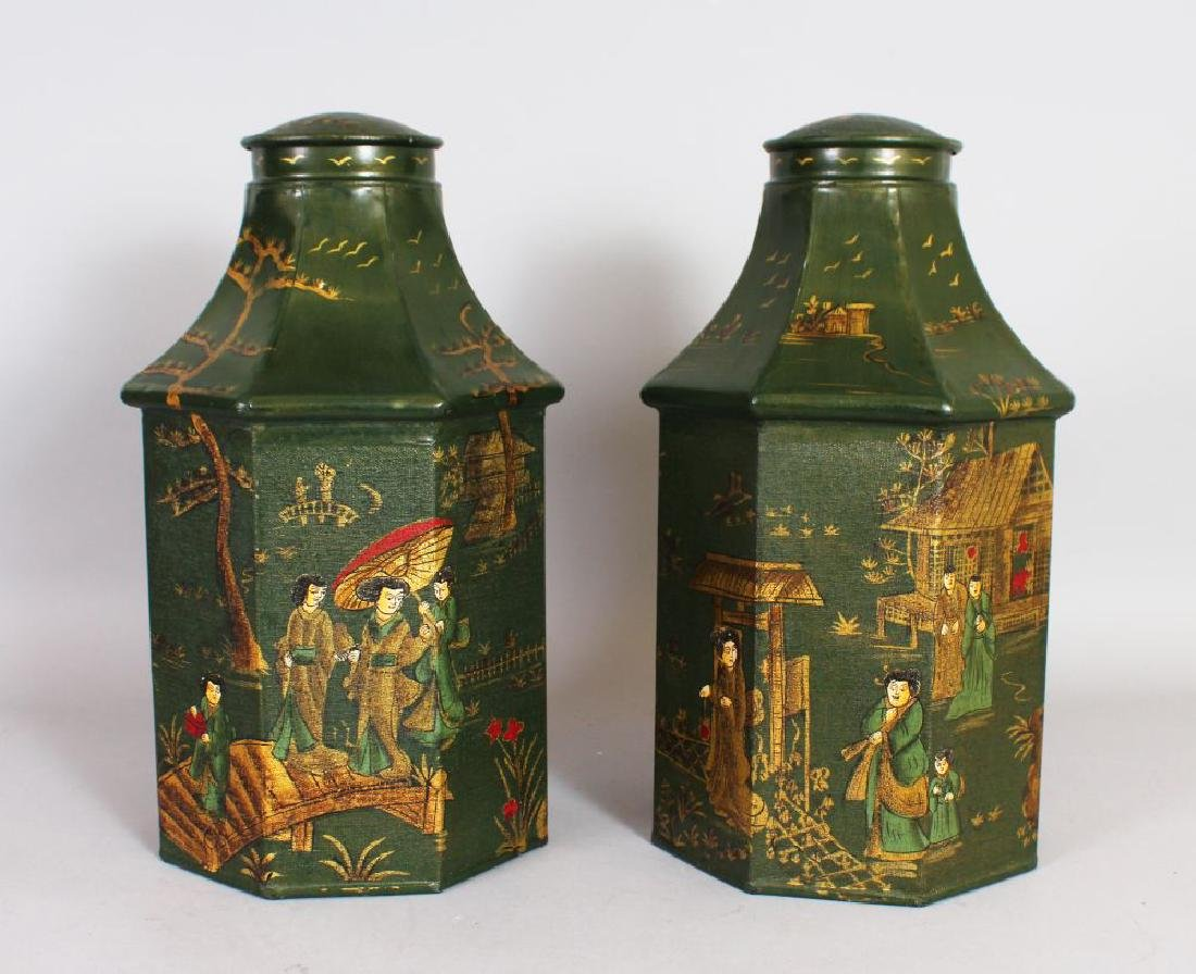 A PAIR OF TOLEWARE TEA CANISTERS, green ground with