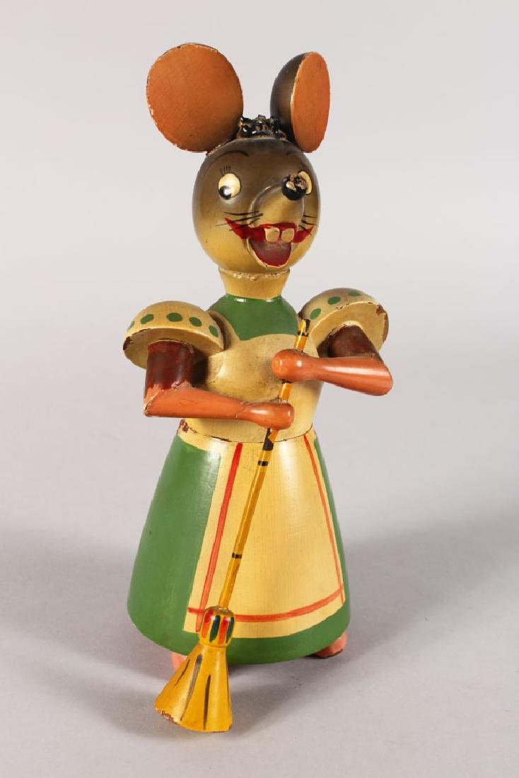 AN AMUSING CARVED AND PAINTED WOODEN TOY MOUSE MONEY