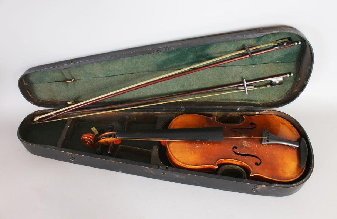 A VIOLIN IN A WOODEN CASE with two bows.