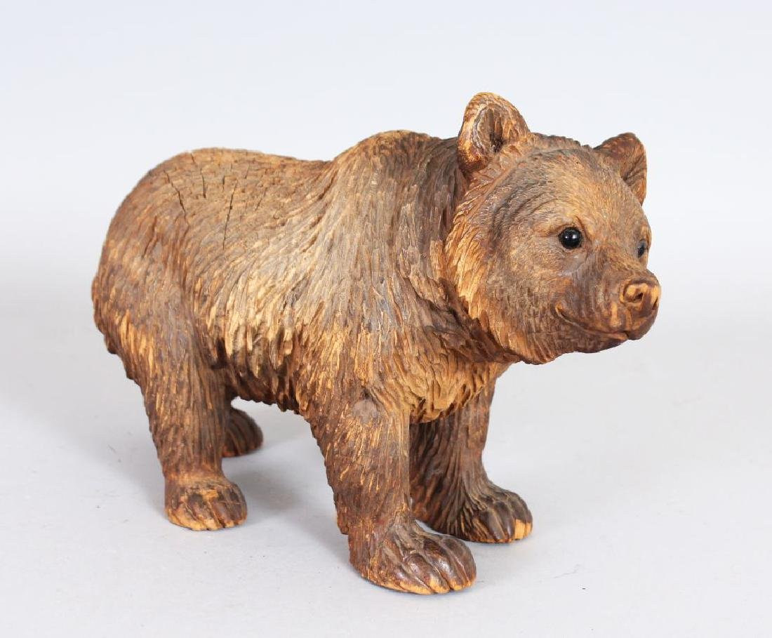 A GOOD CARVED BLACK FOREST BEAR.  9ins long.