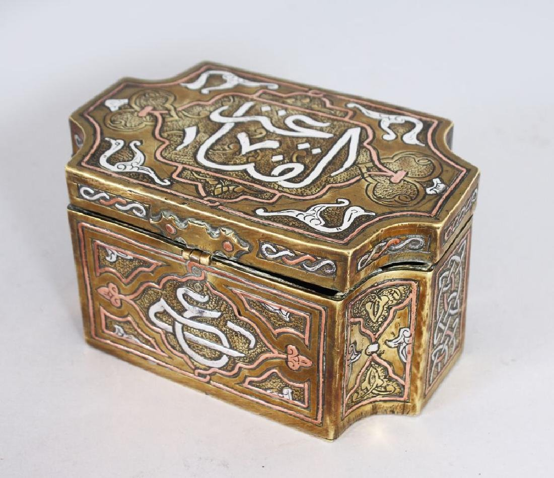 A SILVER INLAID ISLAMIC BRASS BOX.  4.75ins.
