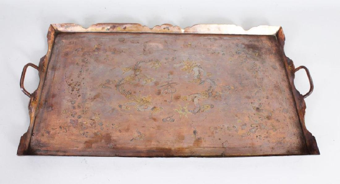 A SILVER INLAID TWO-HANDLED RECTANGULAR TEA TRAY.