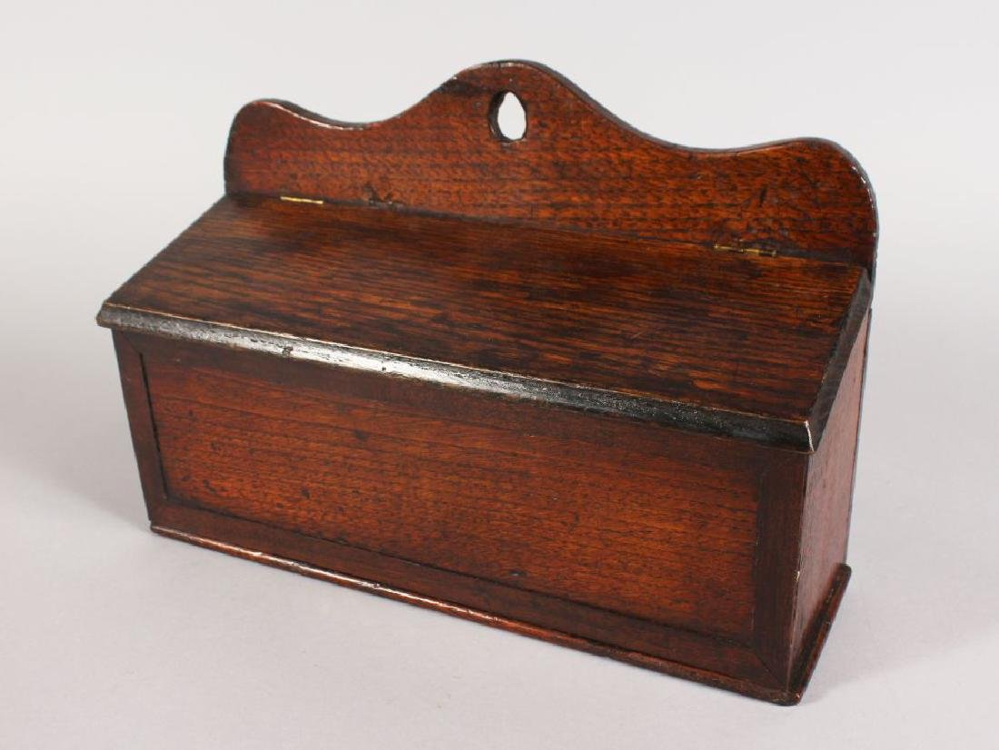 AN 18TH CENTURY OAK CANDLE BOX with lift up flap.