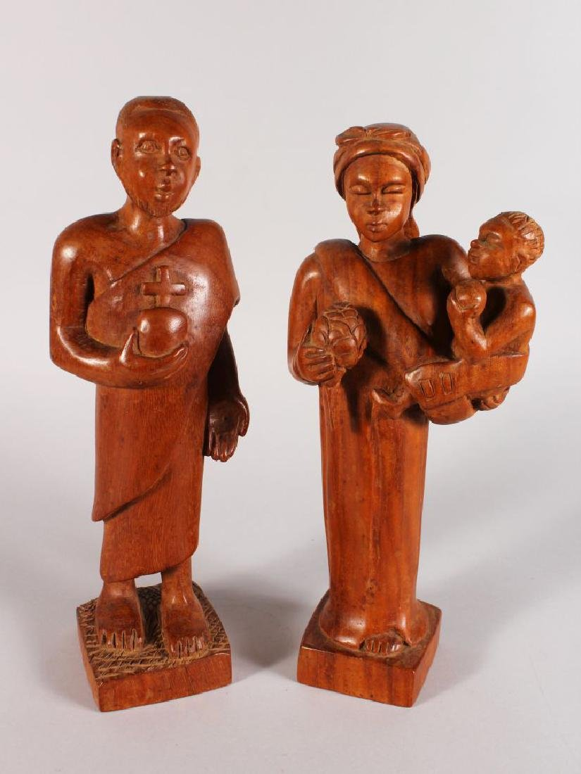 A PAIR OF AFRICAN WOODEN CARVED FIGURES, a woman