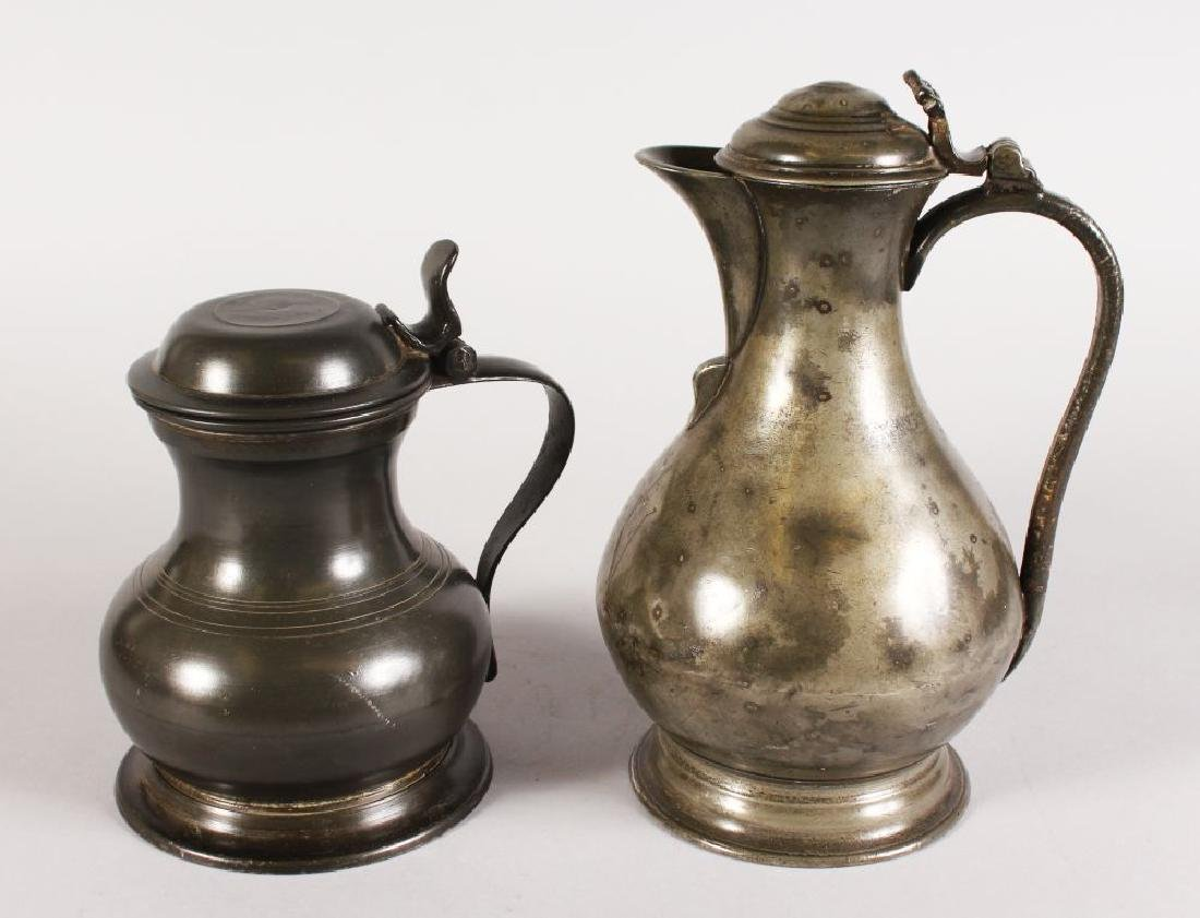 AN 18TH CENTURY PEWTER LIDDED TANKARD and A WINE JUG