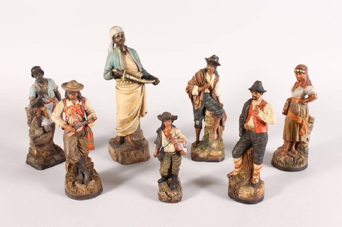 A SET OF SEVEN GERMAN OR AUSTRIAN TERRACOTTA POTTERY