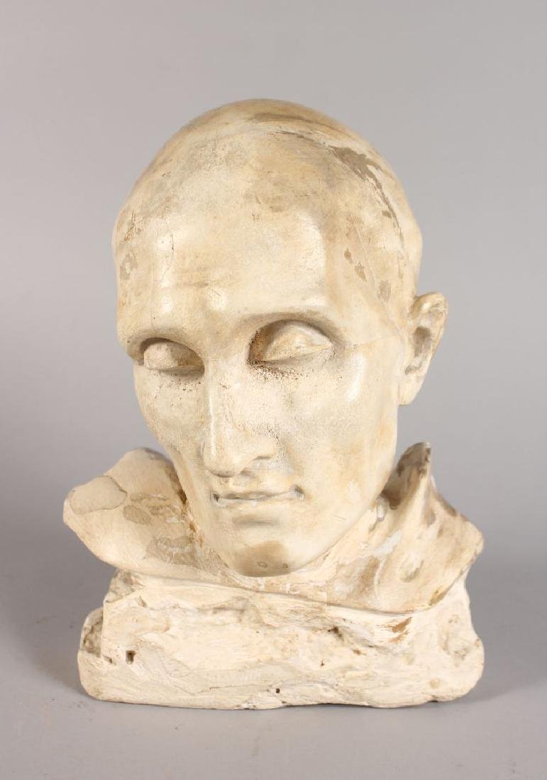 AFTER THE ANTIQUE, A PLASTER BUST OF A MAN.  11ins