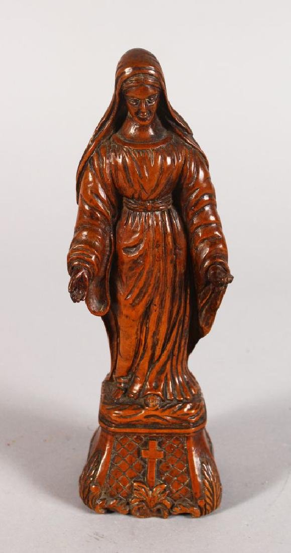 A CARVED BOXWOOD FIGURE OF THE VIRGIN MARY.  8ins high.