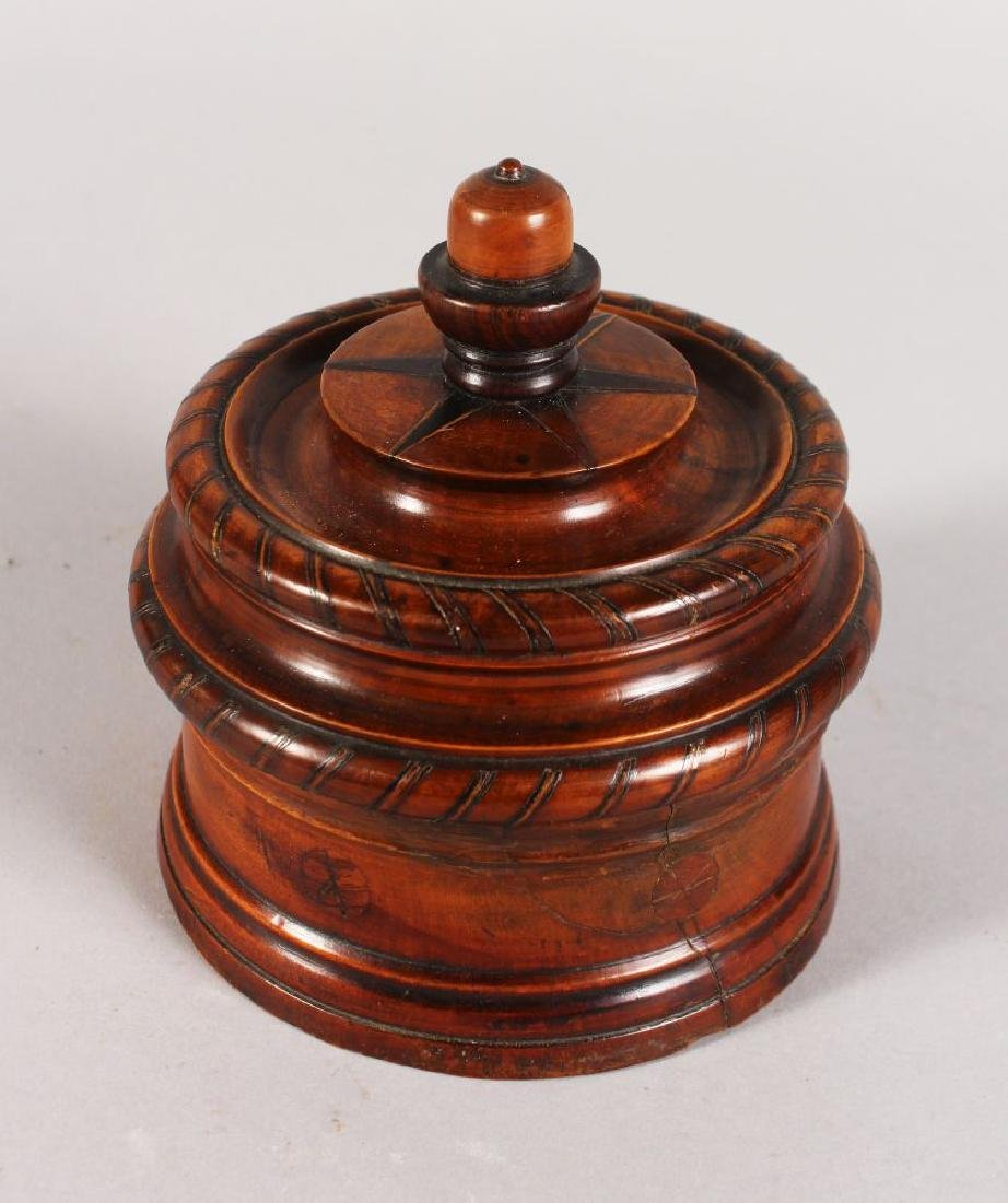 AN 18TH CENTURY TURNED AND INLAID WOOD CIRCULAR TOBACCO