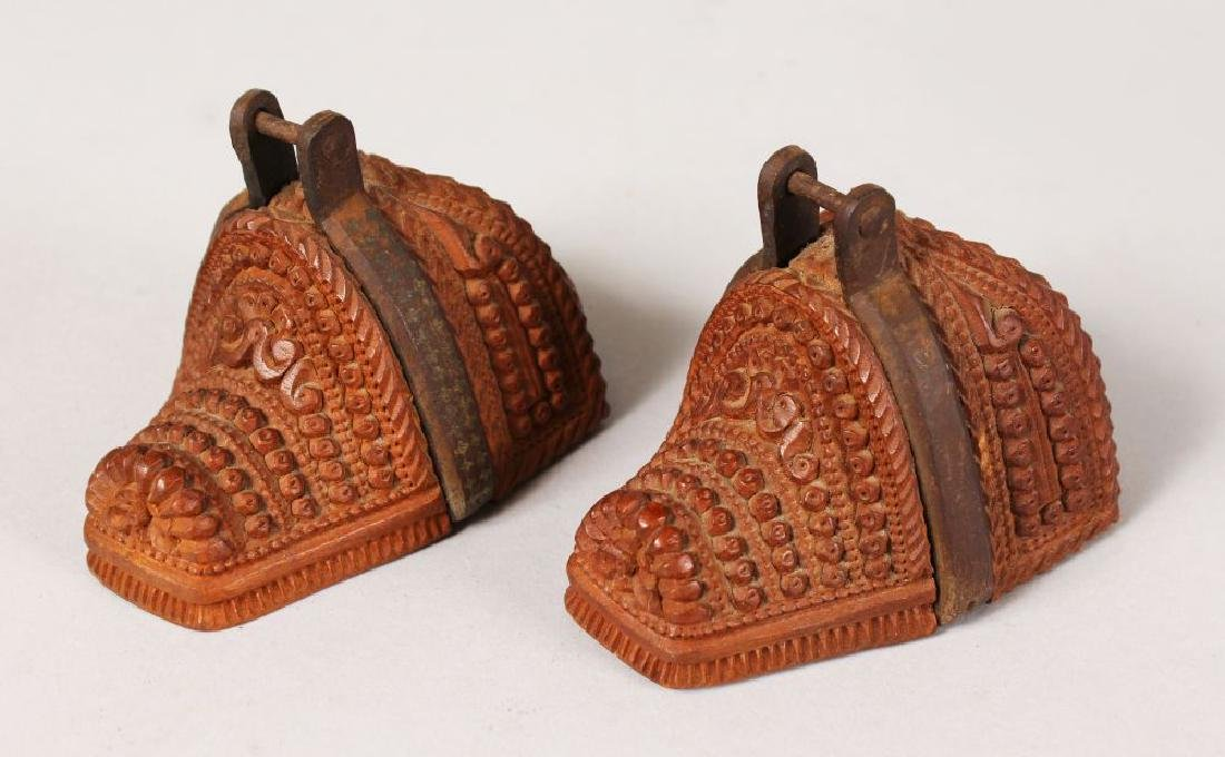 AN UNUSUAL PAIR OF CARVED WOOD MINIATURE SHOES with