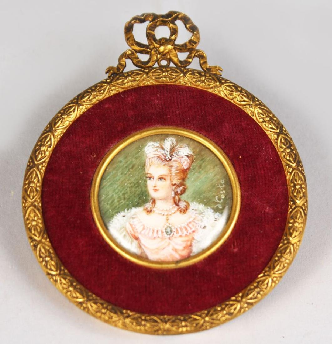 A CIRCULAR MINIATURE OF A LADY WITH FEATHERS IN HER