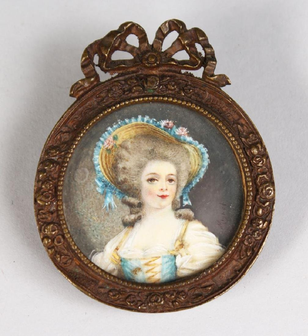 A CIRCULAR MINIATURE OF A LADY IN A LARGE HAT.  2ins