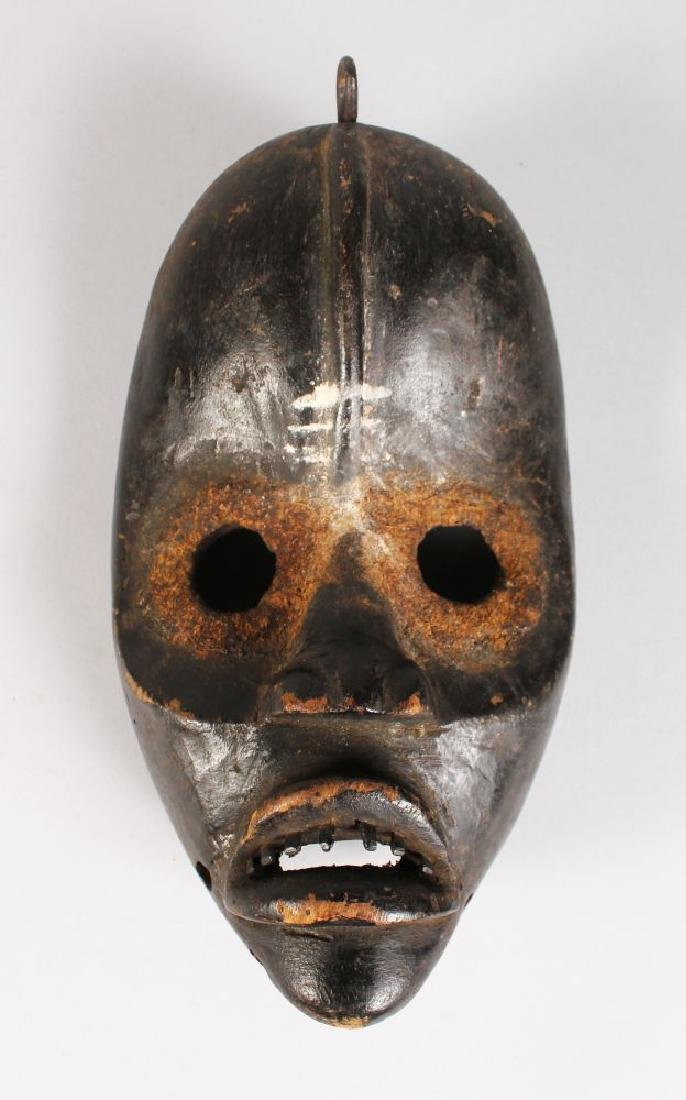 A PAINTED TRIBAL MASK.  10ins long.