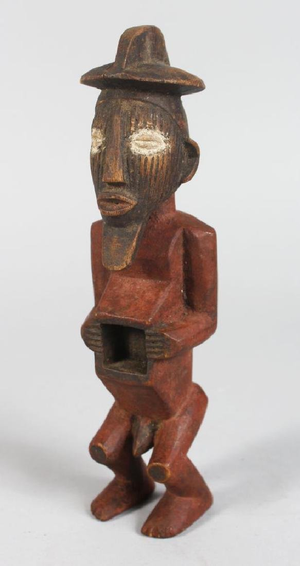 A CARVED TRIBAL FIGURE MAN with open chest.  9ins long.