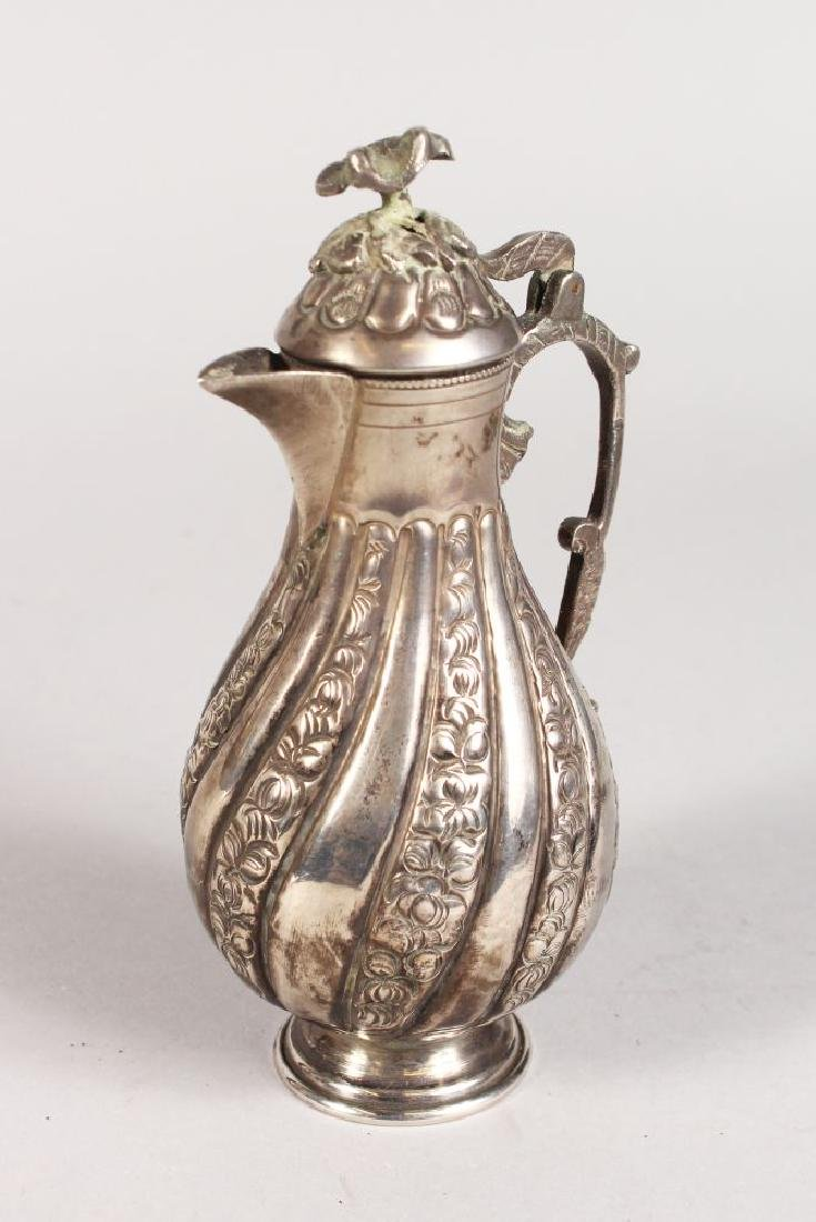 A TURKISH SILVER COFFEE POT.