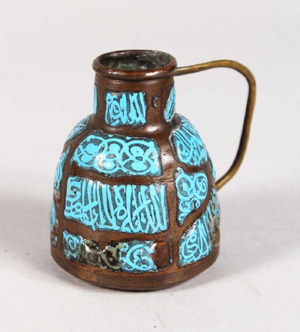 A SMALL ISLAMIC ENAMEL AND COPPER JUG with calligraphy.