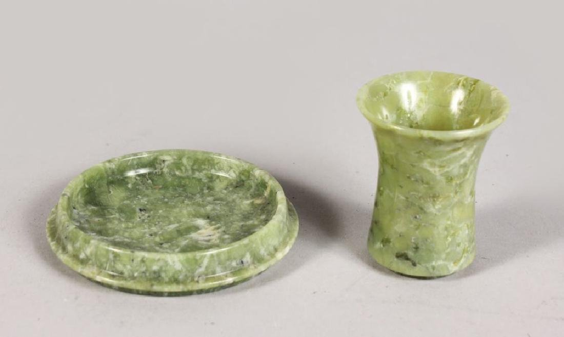 A JADE DICE SHAKER AND COVER.