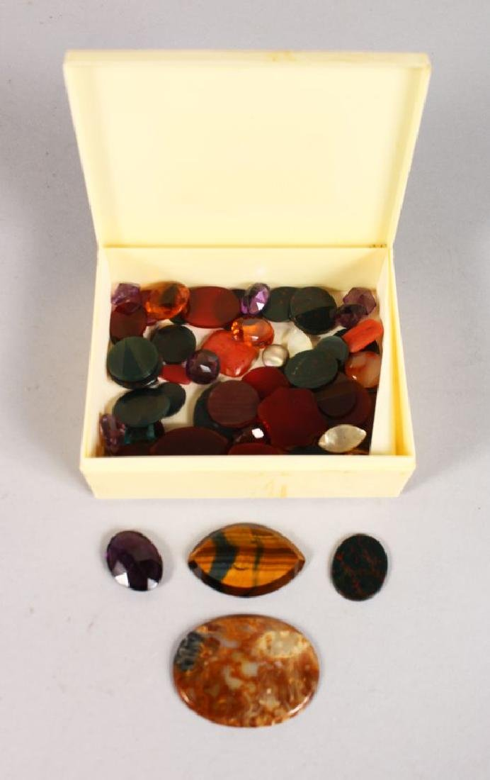 A BOX OF SEMI PRECIOUS STONES.