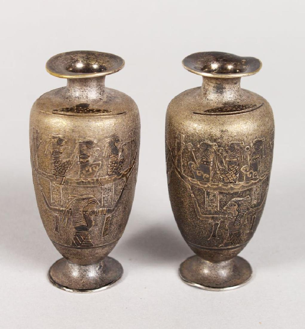 A SMALL PAIR OF EGYPTIAN METAL VASES.  3ins high.