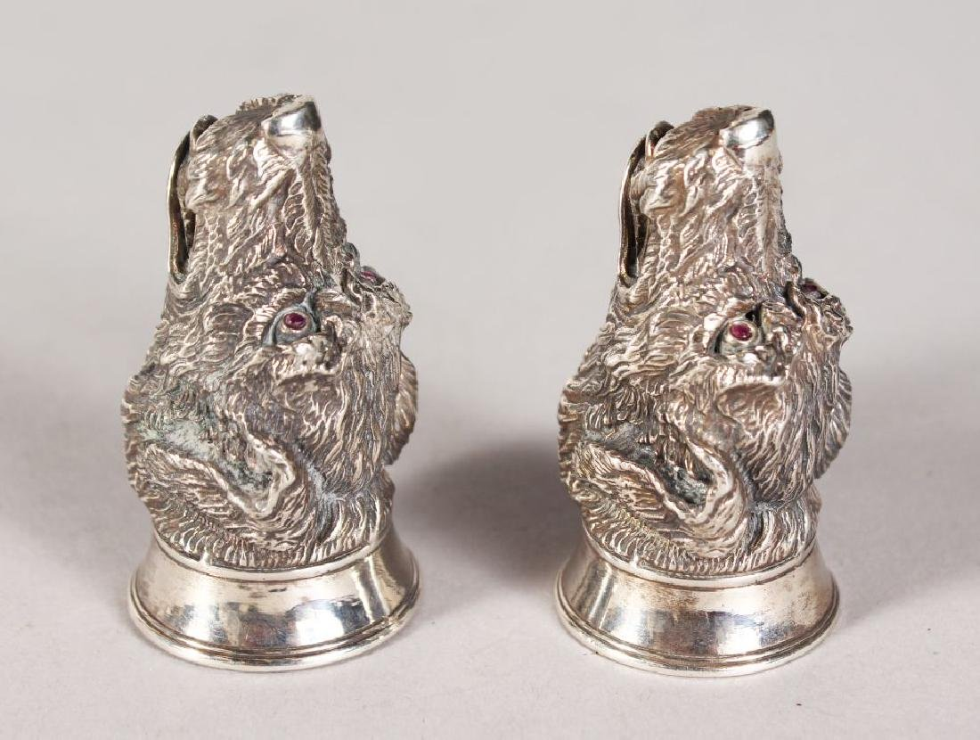 A GOOD HEAVY PAIR OF SILVER SEATED HUNTING DOG SALT AND