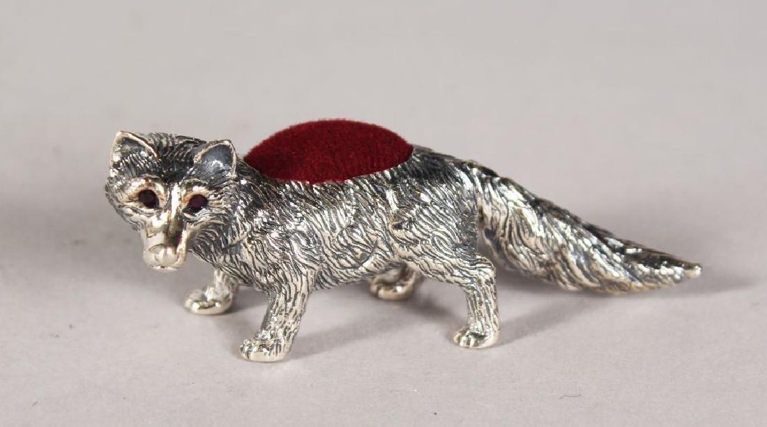 A SILVER FOX PIN CUSHION.
