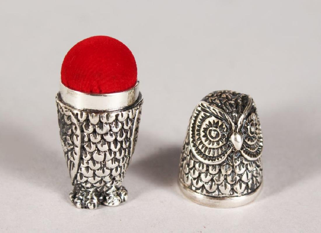 A SILVER OWL PIN CUSHION and THIMBLE CASE.