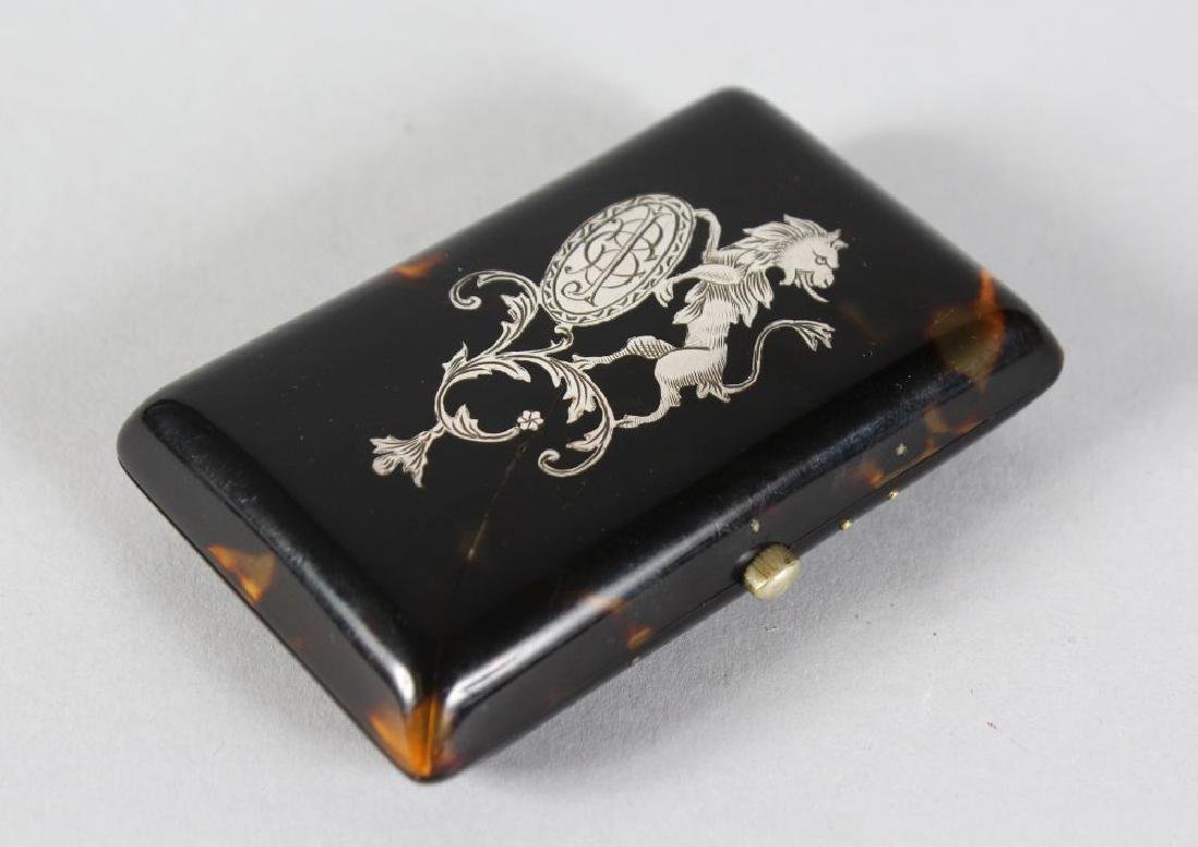 A VICTORIAN INLAID WITH SILVER TORTOISESHELL PURSE.