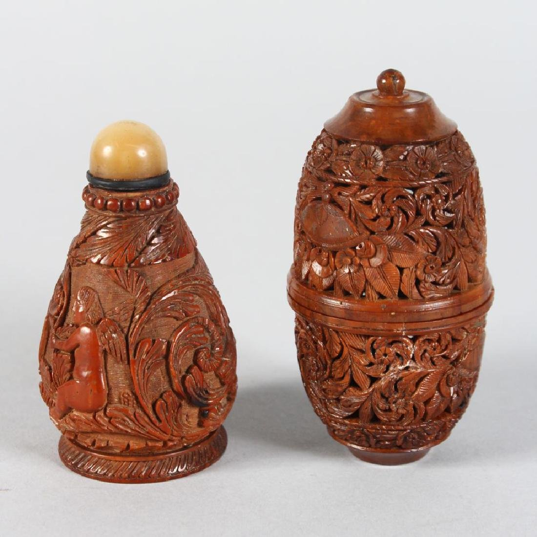 A CARVED SCENT BOTTLE and A HOLDER (2).
