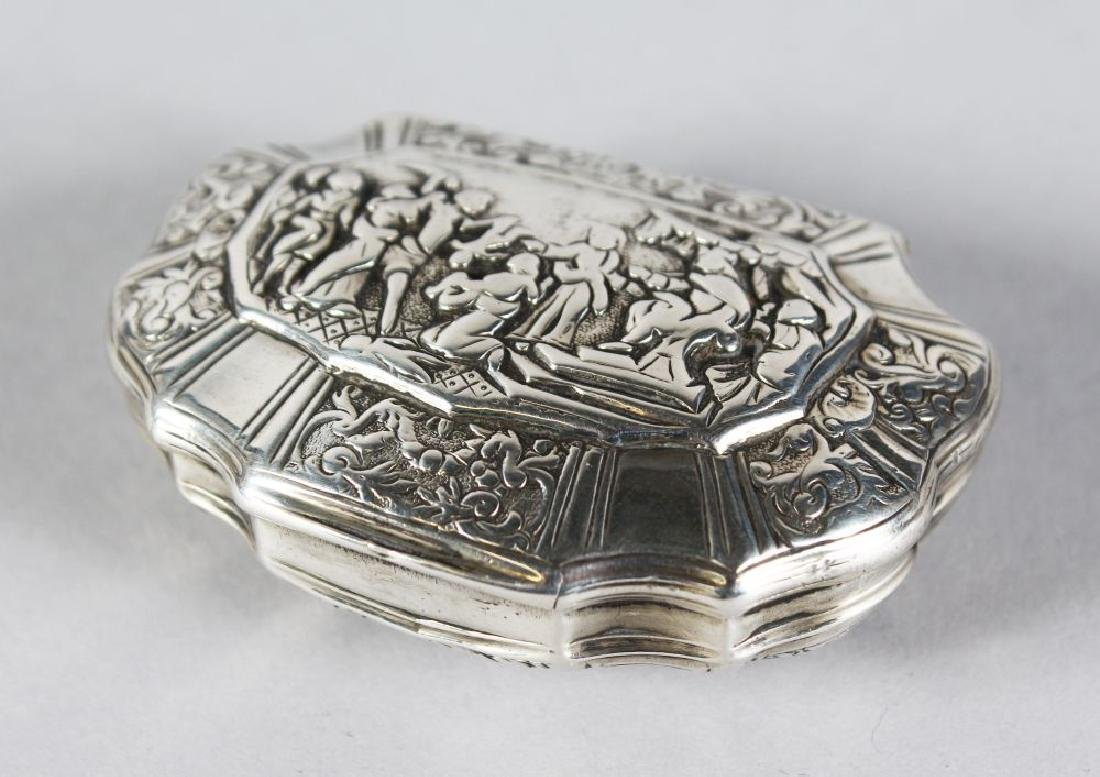 A CONTINENTAL SILVER SHAPED SNUFF BOX, the lid with