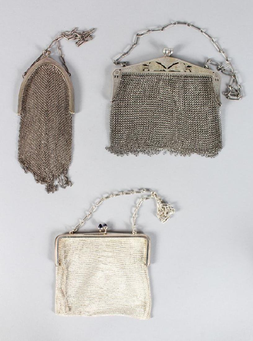 THREE EDWARDIAN SILVER MESH EVENING BAG.