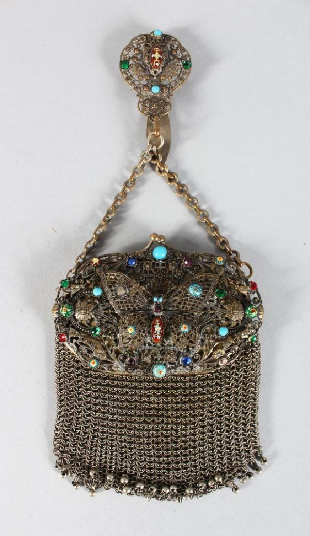 A CHAIN EVENING BAG with coloured stones.