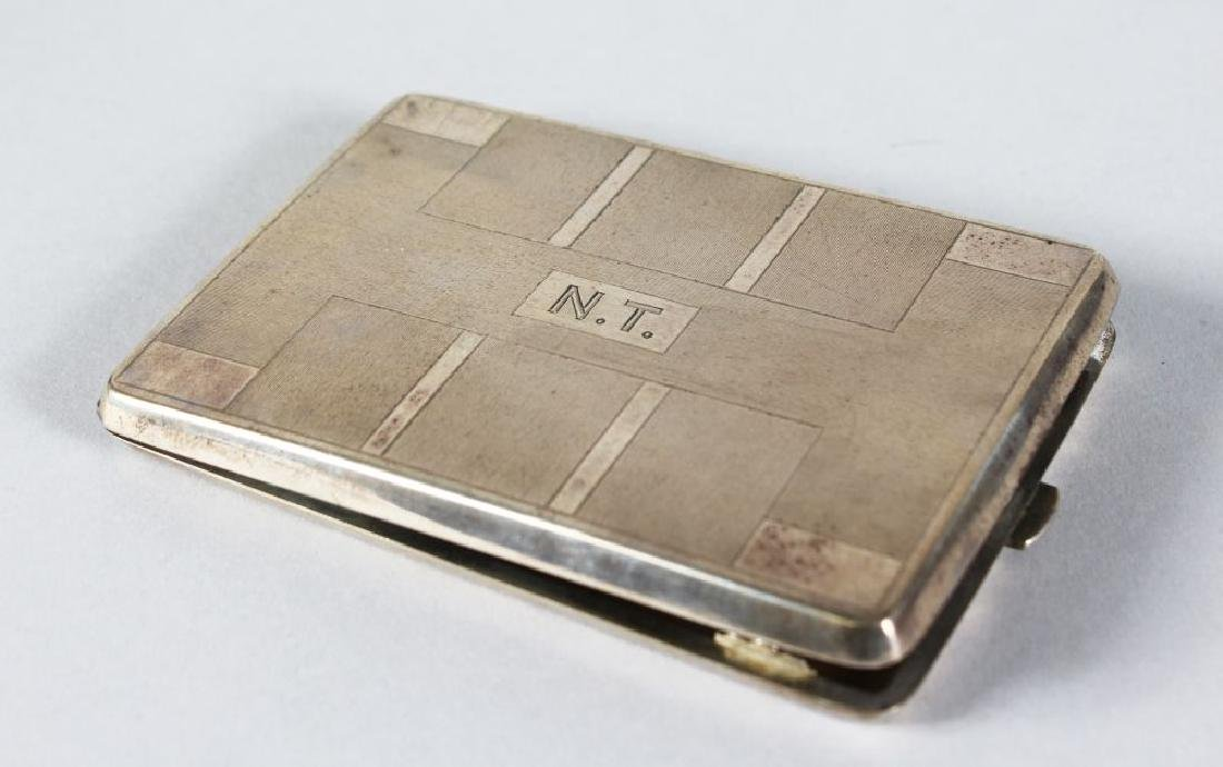 A .800 ENGINE TURNED CIGARETTE CASE.